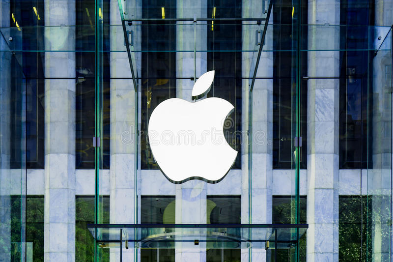 Apple Logo hung in the glass cube entrance to the famous Fifth Avenue Apple Store in New York. Apple Store logo hung in the glass cube entrance to the famous royalty free stock photo