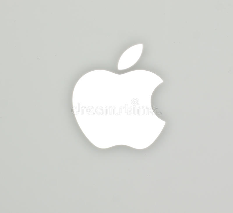 The Apple logo on Mac Book White Notebook royalty free stock photography