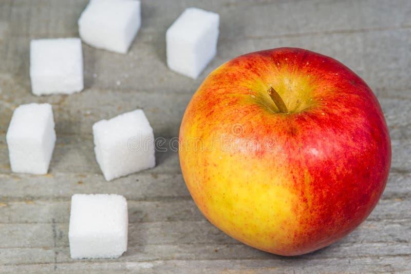 Apple and lump sugar royalty free stock photo