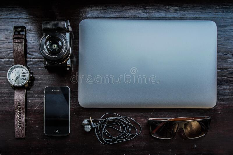Apple Macbook with camera and mobile stock photography