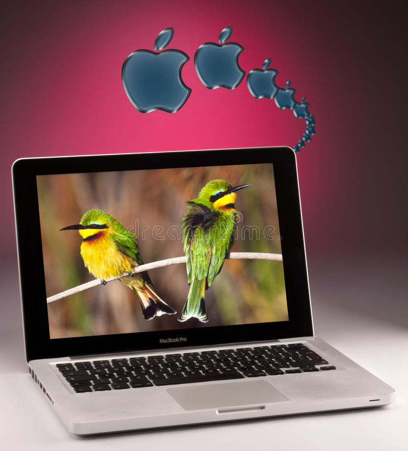 Apple MacBook Pro Laptop Computer. An Apple MacBook Pro Laptop Computer and the Apple Logo