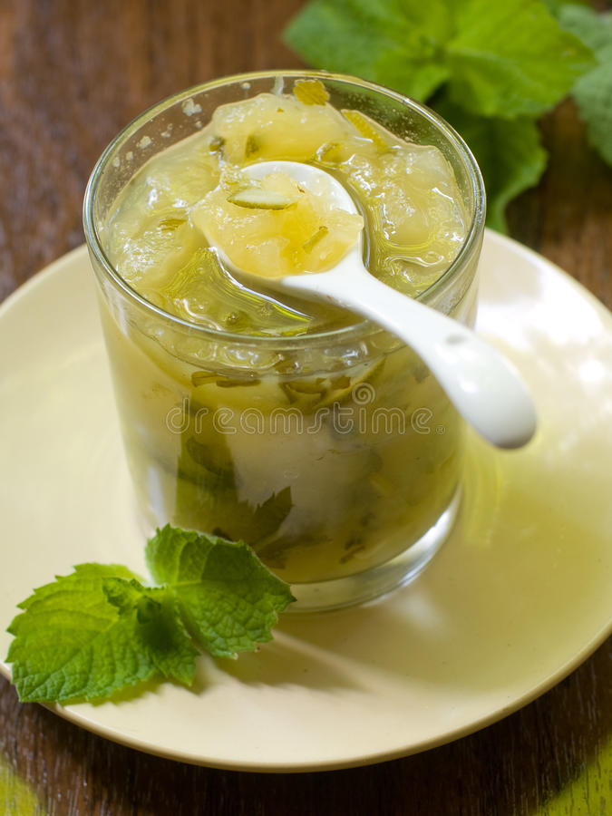 Apple marmalade. Apple-Mint Marmalade in a glass with spoon royalty free stock photos