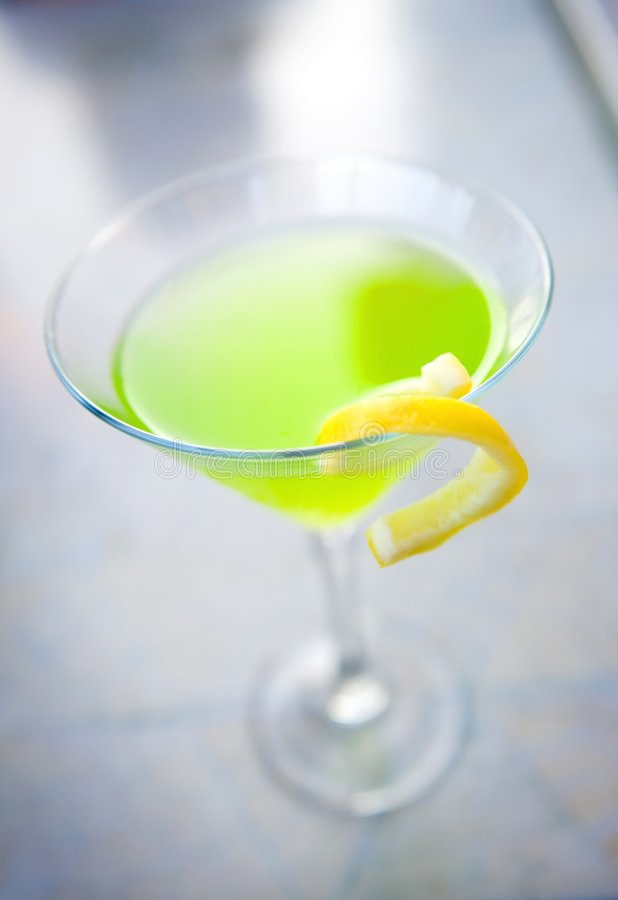 Apple martini with a lemon twist royalty free stock photo