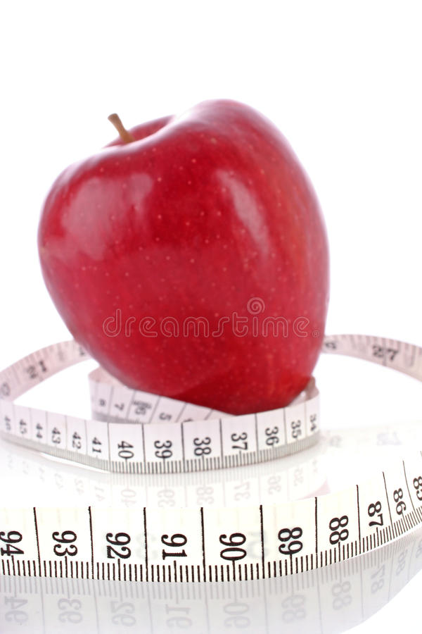 Apple and a measure tape royalty free stock photo