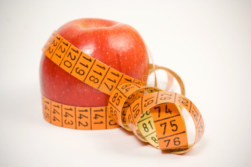 Apple and measurement tape royalty free stock image