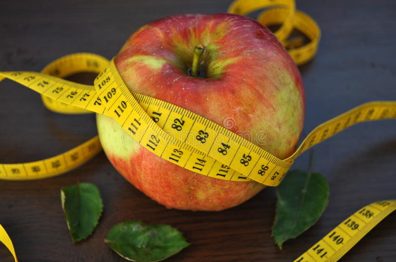 Apple and measurement tape stock image