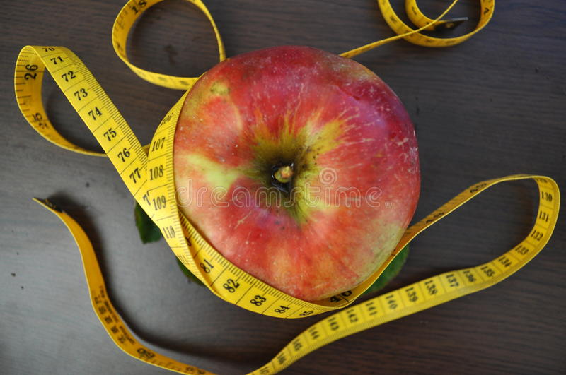 Apple and measurement tape royalty free stock photo