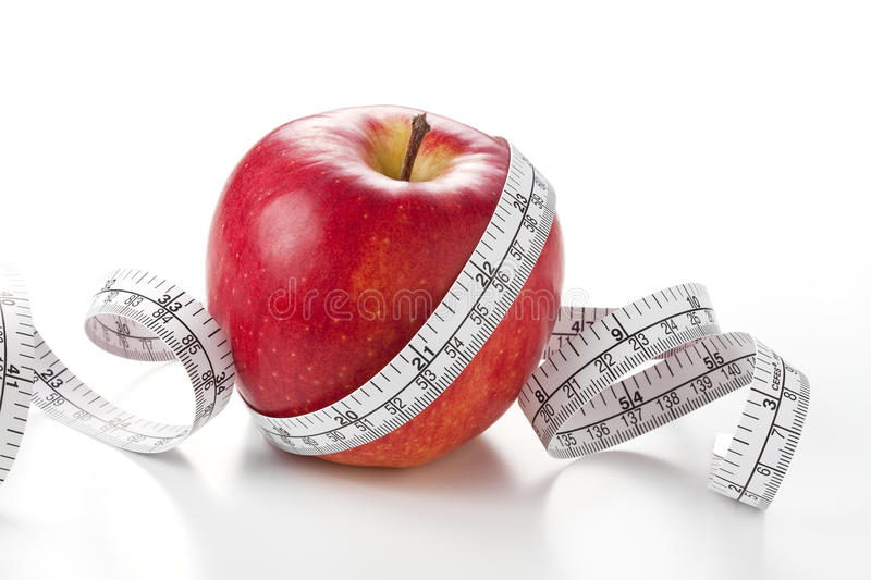 Apple And Measuring Tape Royalty Free Stock Image
