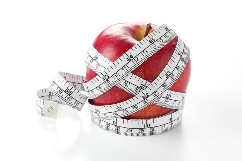Download Apple and measuring tape stock photo. Image of fruit - 23928750
