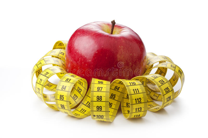 Download Apple and measuring tape stock photo. Image of healthy - 23928758