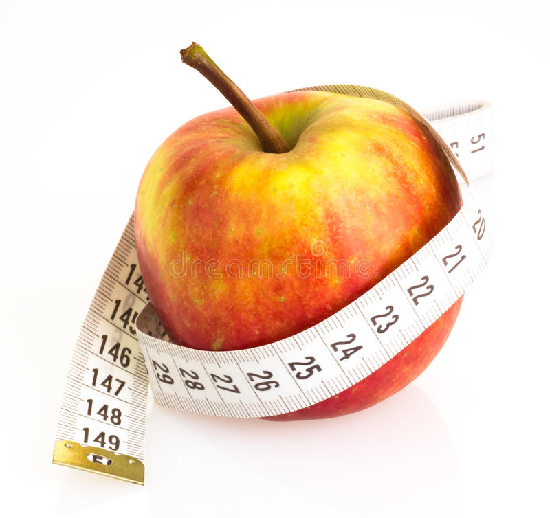 Download Apple with measuring tape stock image. Image of meal - 26447209
