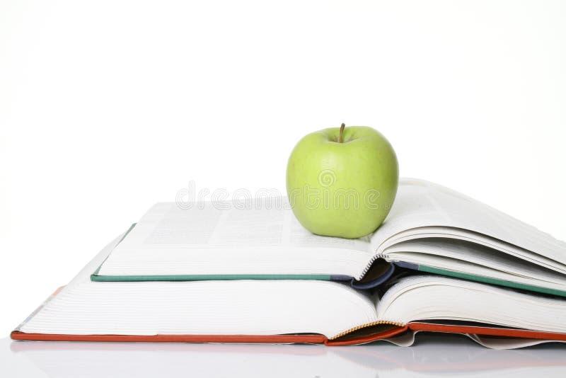 Apple med bokar arkivfoto