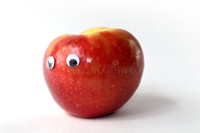 Apple met googleogen stock afbeelding