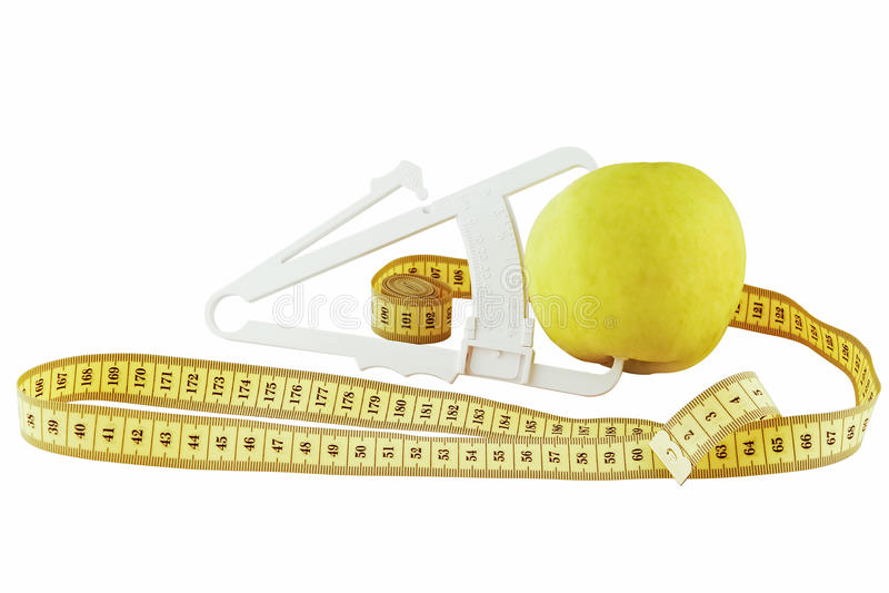 Apple, metr i caliper na białym tle, fotografia royalty free
