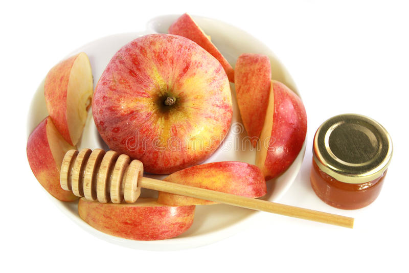 Apple, miel y cuchara de la miel fotos de archivo libres de regalías