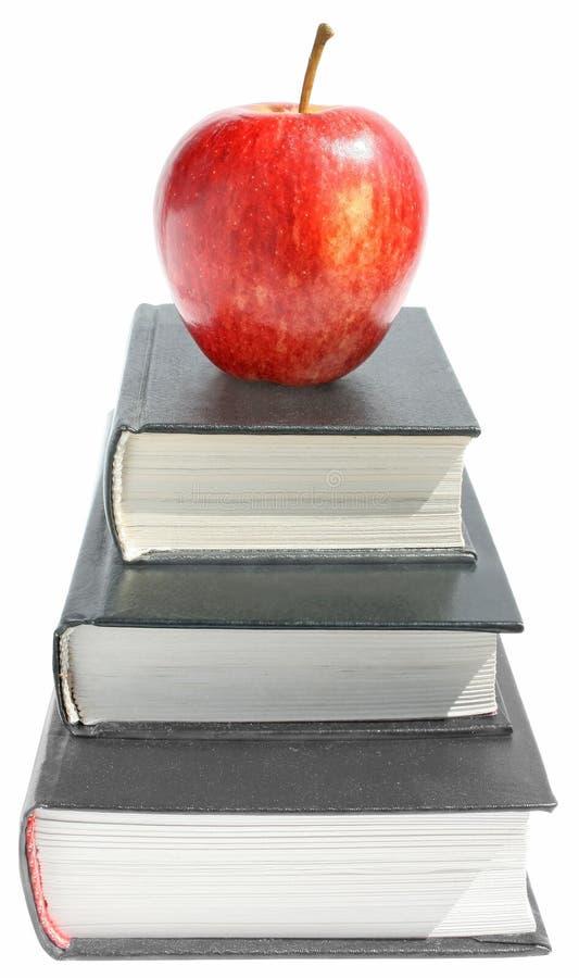 Apple mit den Büchern lizenzfreies stockfoto