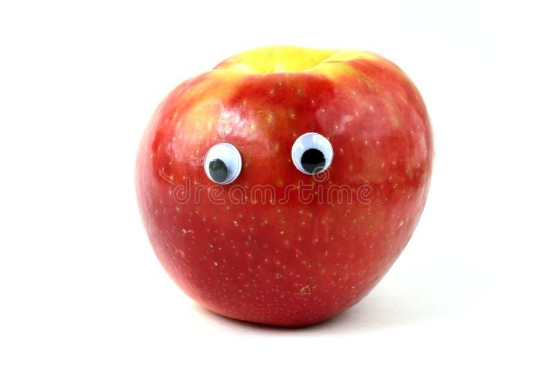 Apple mit Google-Augen lizenzfreie stockfotografie