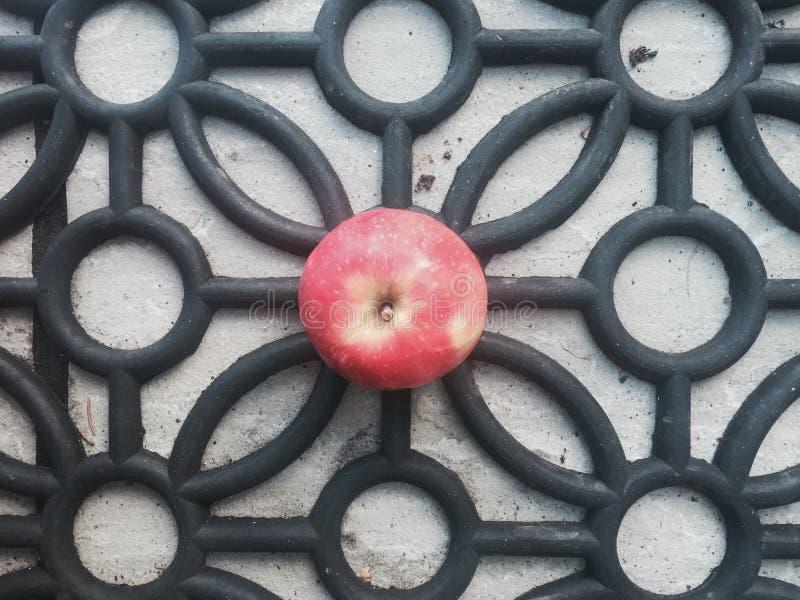 Apple on monochrome pattern stock photos