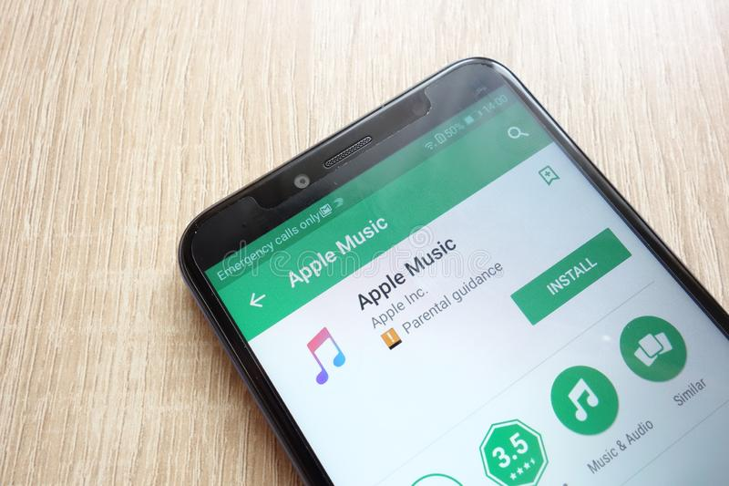 Apple Music app on Google Play Store website displayed on Huawei Y6 2018 smartphone royalty free stock photo