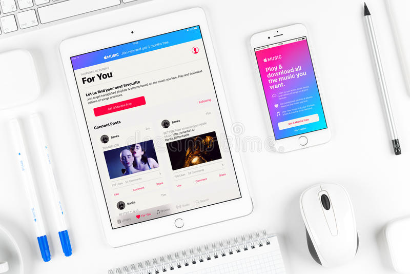 Apple music application on the display of iphone and ipad royalty free stock photos