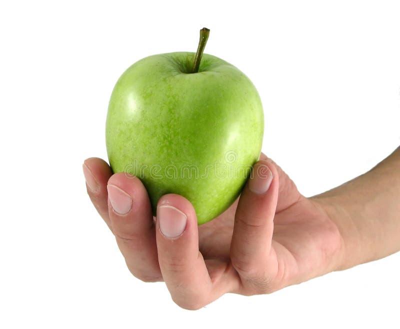 Apple na mão masculina foto de stock