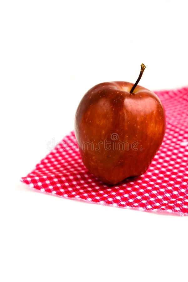 Apple on a napkin isolated on white background stock images