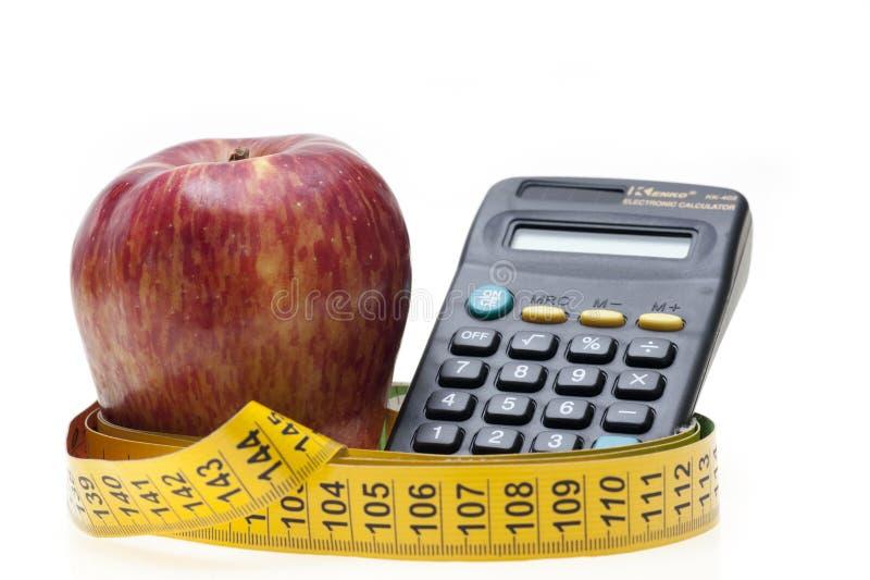 Apple, nastro e calcolatore fotografie stock libere da diritti