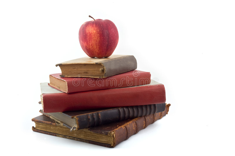 Apple On Old Books Stock Photos