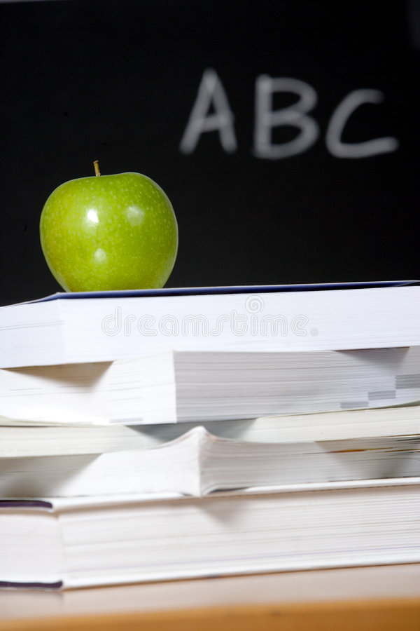 Free Apple On Stack Of Books In Classroom Stock Photography - 5087732
