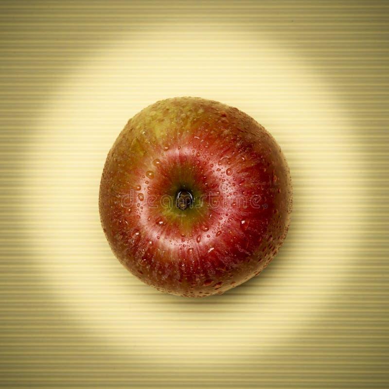 Apple op het beige royalty-vrije stock foto