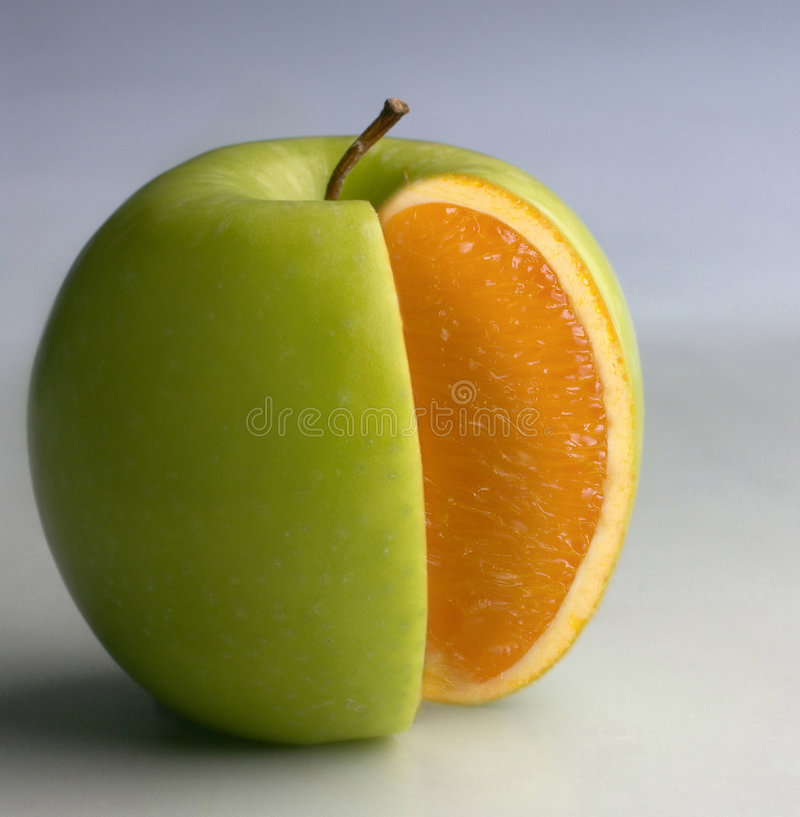 Apple with orange content stock images