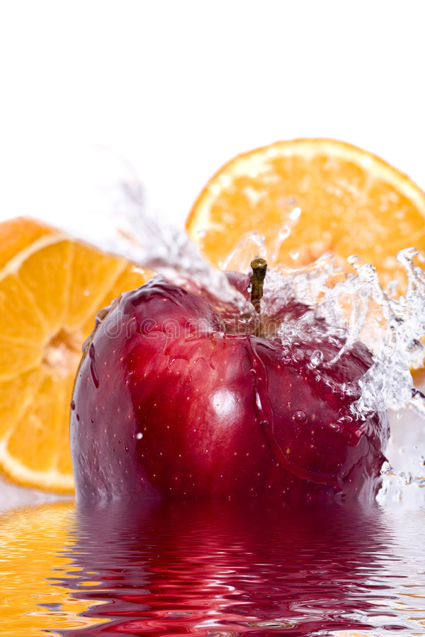 Apple and orange splash stock photo