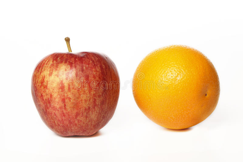 Apple and orange on white royalty free stock images