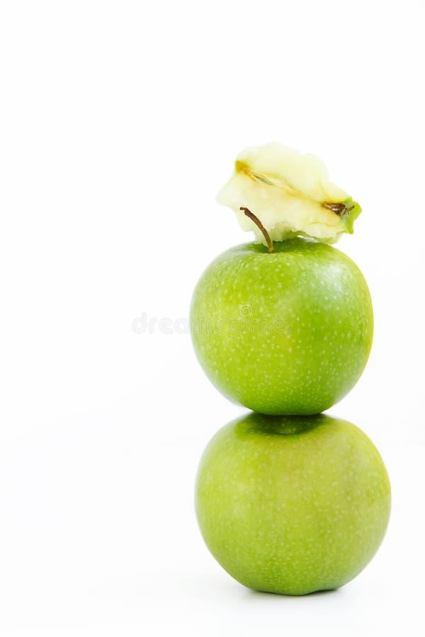 Apple på äpplet och överst av dem stumpen från Apple arkivfoton