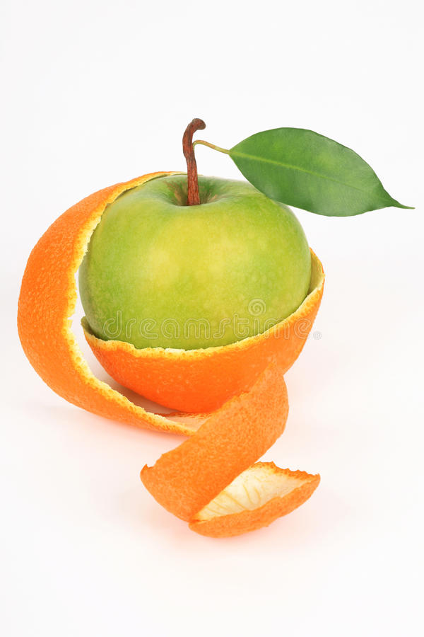 Apple in a peel from an orange royalty free stock photography
