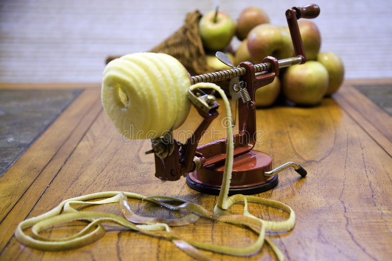 Apple peeler and apples royalty free stock photography