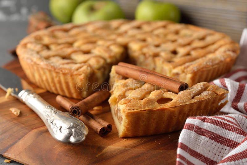 Apple pie with cinnamon. On the gray background stock image
