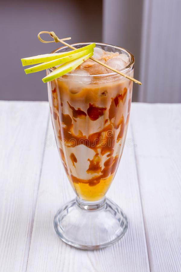 Apple pie cocktail. Milk bright coctail in glass decorated with apple slices. Non-alcoholic summer coctails. Menu of cafe or. Restaurant stock image