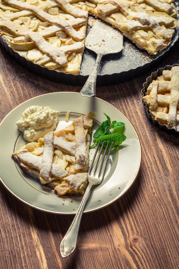 Apple pie with cream and mint leaf stock images