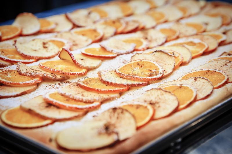Apple pie decorated with dried orange slices and apple slices stock photo