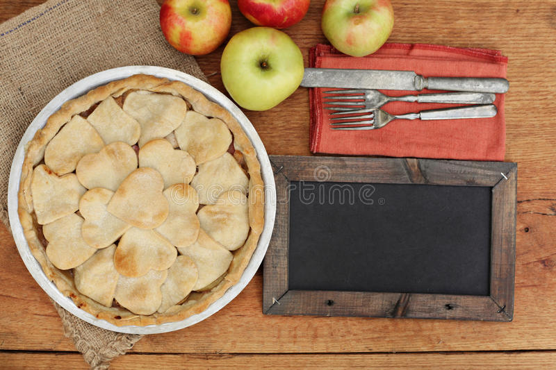 Apple pie with heart shaped crust topping with chalkboard stock photos