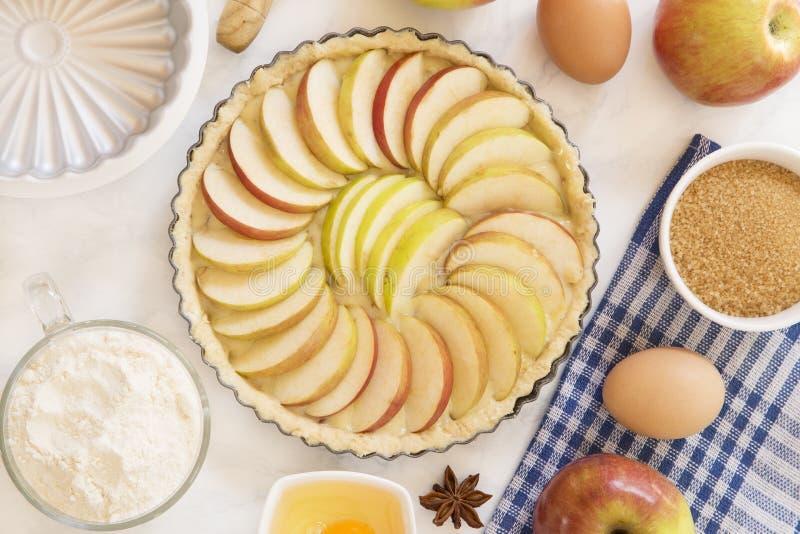 Apple pie preparation stock photo