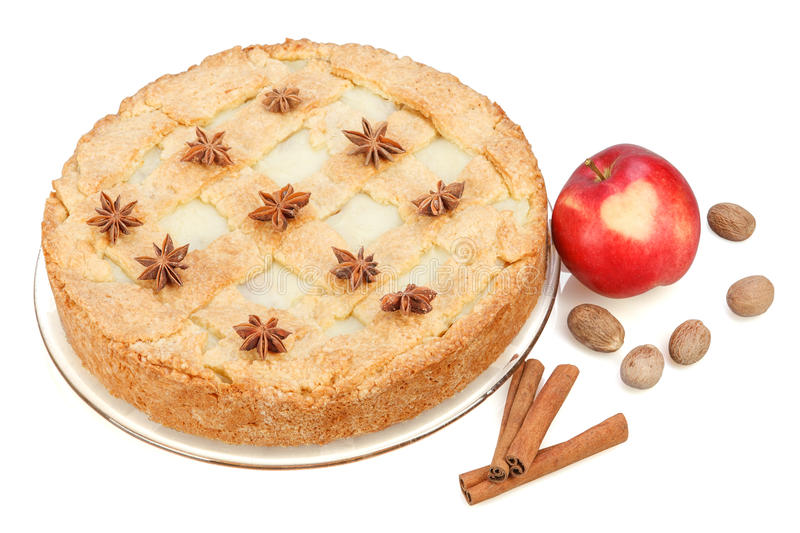 Apple pie with red apple, cinnamon, anise, nutmeg. Isolated on white background. Red apple with heart stock image