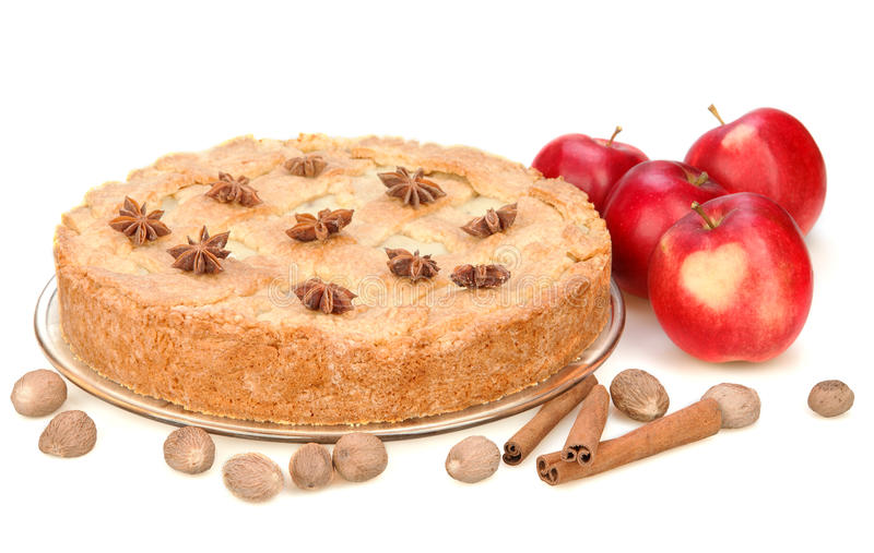 Apple pie with red apples, cinnamon, anise, nutmeg. Isolated on white background. Red apple with heart stock image