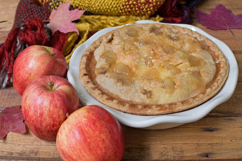 Apple Pie withRed Apples. Apple pie with red apples on a wood surface stock photography