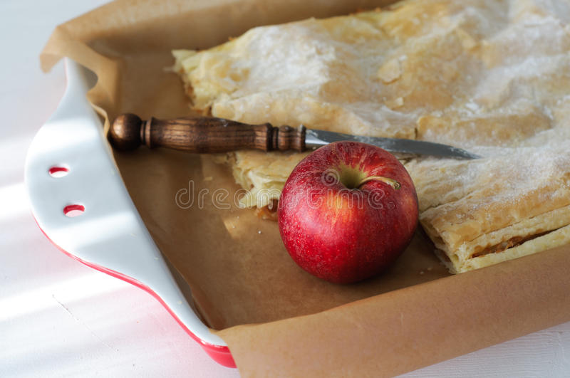 Apple Pie in Red Porcelain Baking Tray - Close Up. Apple Pie and Apple in Red Porcelain Baking Tray - Close Up stock photos