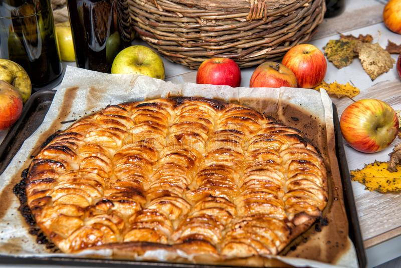 Apple pie with red and yellow apples. An apple pie with red and yellow apples royalty free stock photography