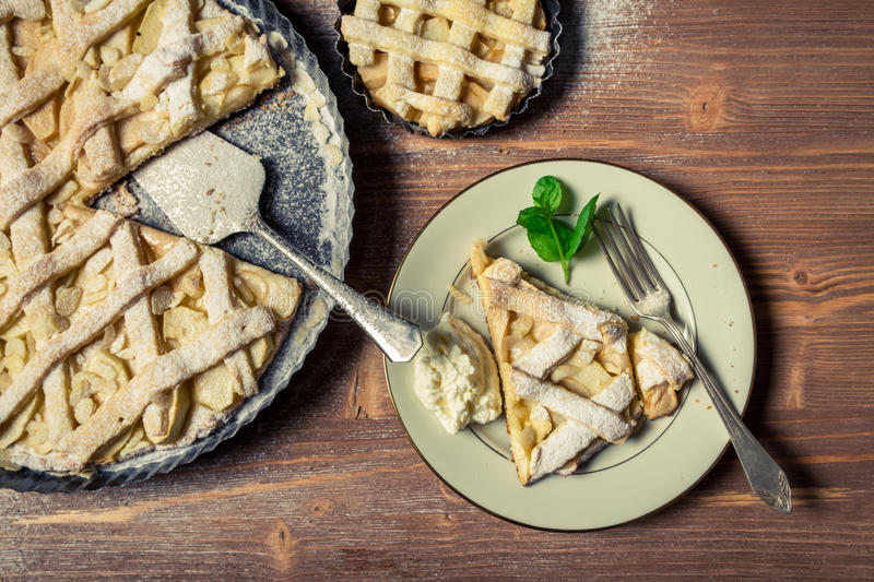 Apple pie served with cream stock photography