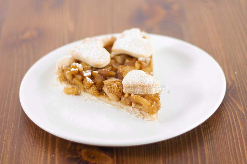Apple pie served in glass service plate stock image
