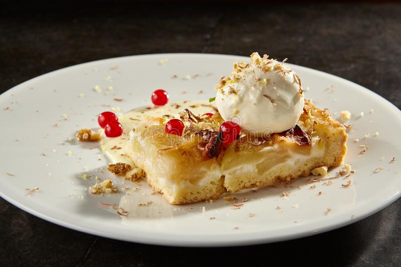 Apple pie slice with ice cream scoop side view royalty free stock photo